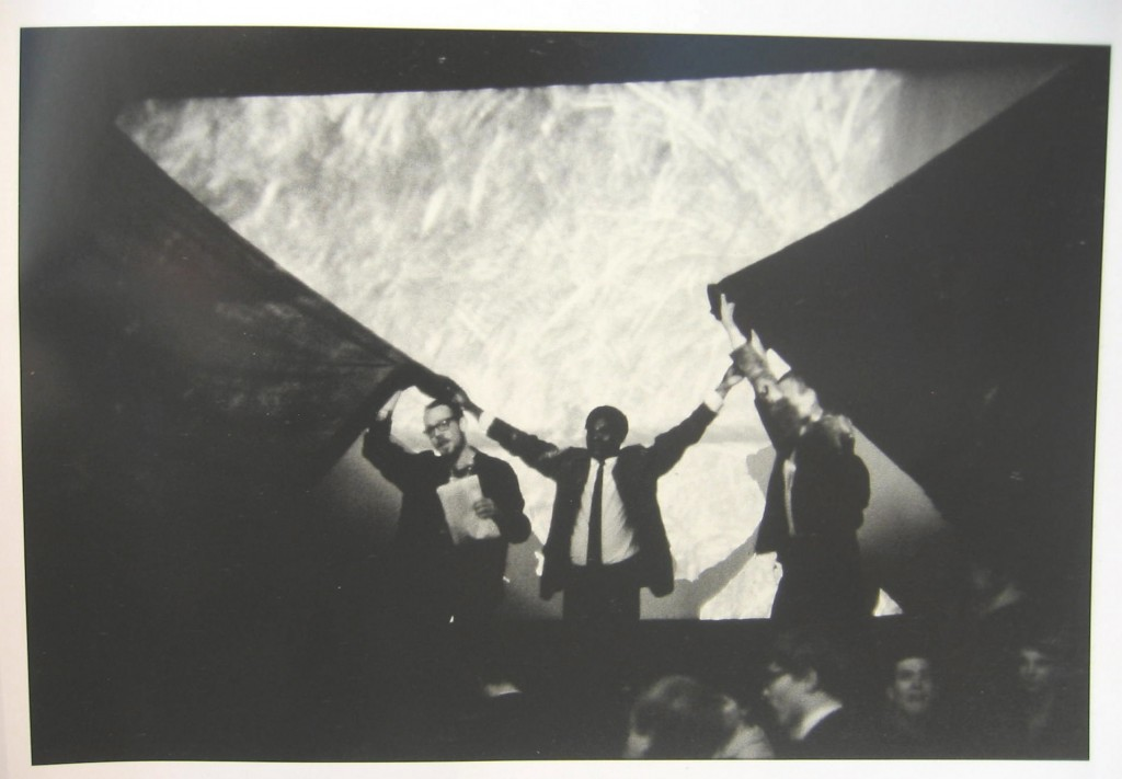 Fig 5. Ajala holding curtains