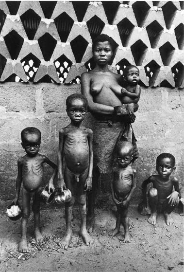 Don T. McCullin, Waiting for Food, Biafra, 1970. Gelatin silver print.