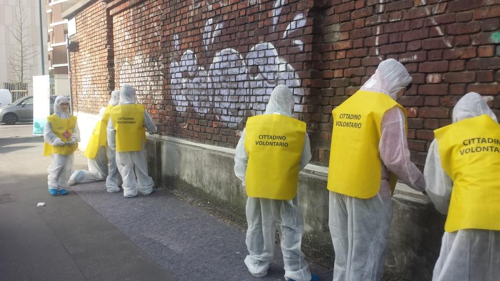 milano  3.05.volounteer citizen reparing Milan after the protests, 3rd May 2015