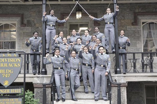 Group photo of young black women raising their fists, set to graduate from West Point, from nytimes.com http://mobile.nytimes.com/2016/05/07/us/raised-fist-photo-by-black-women-at-west-point-spurs-inquiry.html
